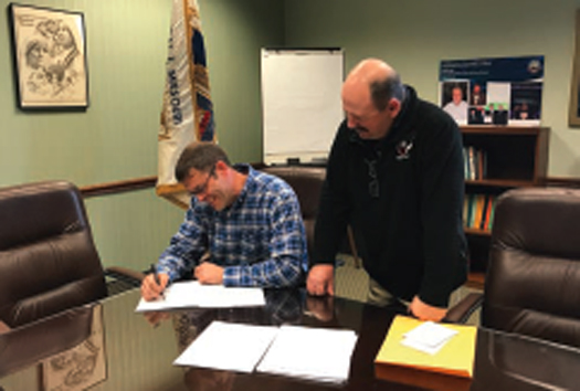 Kyle Schierhoff, owner of Schierhoff Tuckpointing, signing the Local 1 MO Collective Bargaining Agreement with Eastern Missouri Administrative District Council represented by BAC Local 1 MO President Mike Fox, Sr. on January 30th.